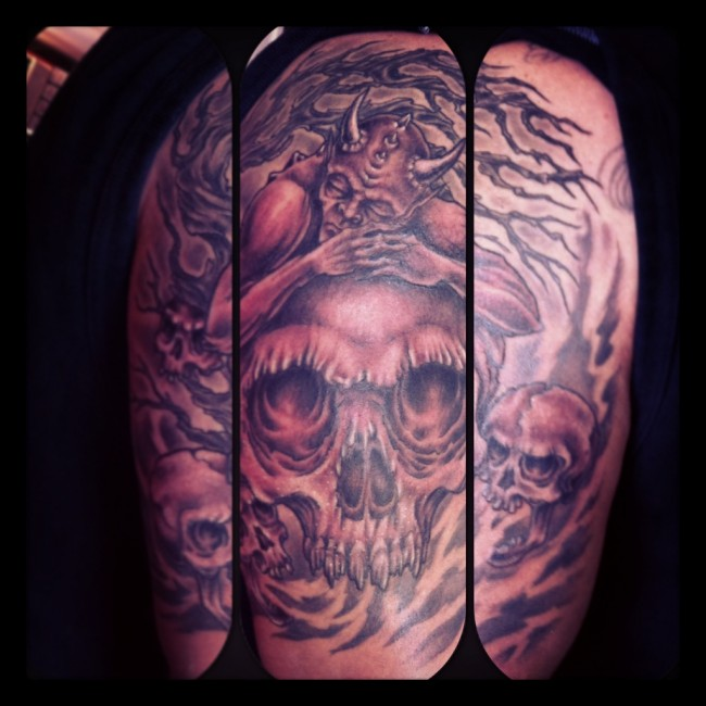 Black and grey demon tattoo